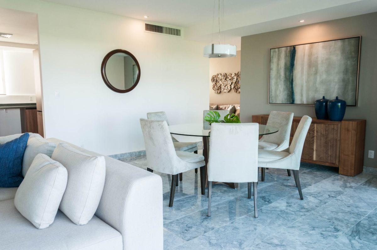 MLS-DCA203 Excelente oportunidad de inversion, Condo a la venta en Cancun Departamento de lujo ubicado dentro de Puerto Cancun, un residencial privado cerca de las zonas mas exclusivas de Cancun. Este desarrollo cuenta con acabados que destacan la exclusividad y confort. Sus amplias terrazas te permiten disfrutar de un hermoso paisaje y de una convivencia al aire libre. Cuenta con amplios jardines, un lobby y gimnasio. Fuera de la torre, se encuentra una piscina de nado y una alberca recreativa, un asoleadero, baños y áreas de convivencia donde el verde predomina con su bella vista al campo de golf. Este departamento te frece extraordinarias amenidades con espacios amplios en un ambiente agradable donde encontrarás sin duda, tranquilidad y confort. amenidades •Seguridad 24/7 •Lobby •Cuarto de juegos •Alberca de nado y recreativa •Asoleadero •Grandes jardines •Spa y sauna •Gym •Cancha de Paddle Tennis •Cancha de fútbol y basquetbol •Business center •Kids club •Salón de usos múltiples •Bodega •Estacionamiento •subterráneo y de visita 2 recamaras 2 baños 158 m2 $ 6,901,000 MXN ($ 363,211 USD) 3 PENTHOUSE recamaras 3 y un medio baño 313 m2 $ 12,844,000 MXN ($ 676,000 USD) El precio puede cambiar de acuerdo a la disponibilidad, demanda y al avance de la obra, contactanos para confirmar el precio actual. #iowncancun #cancunrealstate #cancuncondos  #puertocancun #cancuncondominiums #cancunbroker #cancunlisting #cancunrealty #cancun #cancunlifestyle #Luxurycancun. EasyBroker ID: EB-EA0253 21